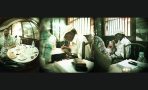 A Parsi gentleman in the checkered shirt at random buys lunch for an old homeless man at the irani restaurant Merwans.