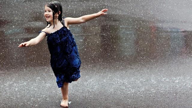 People___Children_Happy_child_runs_in_the_rain_071448_
